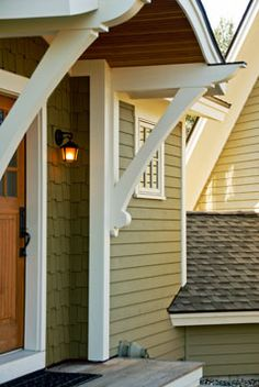 brackets and little porch roof...love the craftsman details. Above the man door to the garage