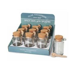 "Glass jars have cork tops which keep spices fresh when not in use.Individual honey or spice jar with spoon, 4""Olde Thompson"