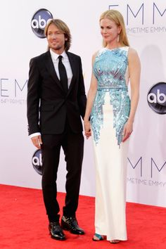 Keith Urban, in Prada, with Nicole Kidman, in Antonio Berardi, with Fred Leighton jewels and Christian Louboutin shoes. #emmys