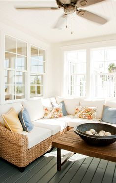The sunroom is so cozy… I would love to read here. The pillows are also great. They're happy and feminine.