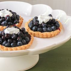 Easy tarts spread with softened cream cheese or mascarpone, piled high with fresh blueberries, and drizzled with blueberry glaze. #SundaySupper #tarts