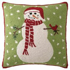 """Hand-hooked wool and cotton pillow with a snowman motif.  Product: PillowConstruction Material: Wool, cotton cover and polyester fillColor: Green, red and creamFeatures:  Insert includedHand-hooked Dimensions: 18"""" x 18"""""""