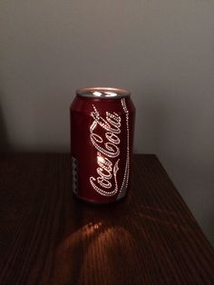 Cool! Poke holes in a empty soda can and put a light inside! Only HOW would you get the light in…
