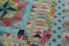 Colorful patchwork quilt with scrap quilt border. Great way to use up fabric scraps.