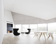 Angular concrete house in Germany mimics a crystal - Curbedclockmenumore-arrow : Get a load of its pared-back style