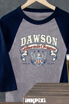 7946d62bb American Original Sports Grey/Navy Adult Raglan 3/4 Sleeve T-Shirt.  Officially display your name on an American Original personalized ...