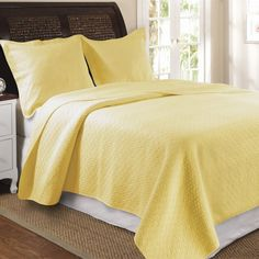 Pretty Yellow Cotton Quilt Set - love this shade of yellow. I would probably add a few more throw pillows in burnt orange with a pattern and a chocolate brown soft throw blanket across the bottom corner of the bed.
