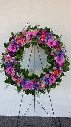 Stunning Open Funeral Wreath of Iris, Pink Gerberas, Matsomoto Aster, Rice Flower, Lilac and wax flower.