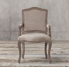 RH's Vintage French Camelback Cane Back Fabric Armchair:Our chair's curvaceous lines and generously padded seat recall the lavish style of 18th-century France, and the aesthetic favored by Louis XV. Distinguished by a scalloped seat, a light and airy caned camelback and carved cabriole legs, the soft finish lends it modern understatement.