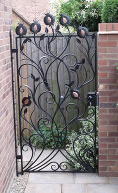 It's lovely to meet a client with an appreciation of the craft and blacksmithing. This beautiful gate - designed and created by Adrian - features repoussed copper inserts, bevel and tapered scrolls, branch and fire welded stems.