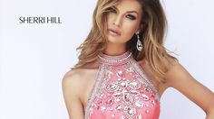 Yards of soft chiffon enshroud the A-line silhouette of Sherri Hill 11228 prom dress, brushed up with a luxurious spread of crystal beadwork running from the halter neckline down to the natural waist. Beneath, the multiple layers of fabric transition into a full circle skirt that finishes with a fabulous flounce. Also available in Light Green, Light Blue and Orchid. #prom #dress #sherrihill
