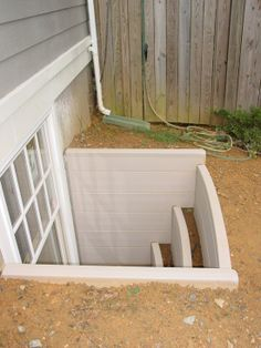 Great idea for a basement egress window.  Window box type steps, planted with flowers, bring a little of the outside into the basement and can be used as stairs in an emergency (page 21).