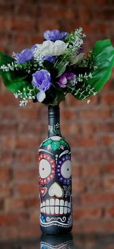Mexican Day of the Dead Sugar Skull, decorated bottle. Vase/ candleholder. Metallic.