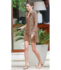 @Who What Wear - Stripped down can be dramatically stunning.  Here Kerr accessorizes a leopard print shirt dress with nothing but natural leather K. Jacques sandals.    On Kerr: Equipment Shirtdress; K. Jacques St. Tropez Picon Sandal ($255)  Alternatives:  Juicy Couture Silk Leopard Shirt Dress ($228)