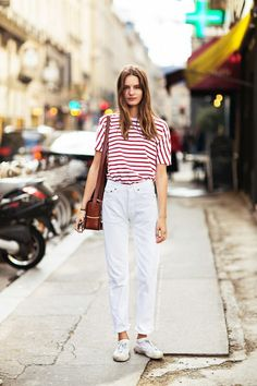 Red and white striped t-shirt, white high-waisted jeans, and sneakers