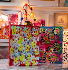 Super fun idea...brown grocery bags....painted As gift bags I want to do this !!