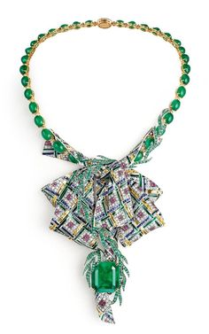 """CHAUMET est une fête collection- """"Pastorale Anglaise"""" transformable necklace in white Gold, yellow Gold and lacquer, set with an emerald-cut Vivid Green Emerald of 28.98 carats from Colombia Muzo, 32 cabochon-cut Emeralds from Zambia, round Rubies and Emeralds, baguette-cut Saphhires and yellow sapphires, and brilliant-cut Diamonds. The bottom part of the necklace can be detached."""
