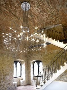 Eclectic Staircase with Hardwood floors, High ceiling, Metal staircase, Chandelier, Fontana Suspension by Orazio Spada