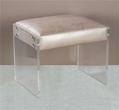 (http://www.zinhome.com/nori-champagne-leather-ottoman-with-acrylic-legs/)