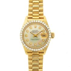 "Rolex Lady Datejust President Watch with Mother of Pearl Diamond Dial Model 69178 - Rolex Oyster Perpetual Lady Datejust, Pre-owned, 18K yellow gold, Custom White Mother-of-Pearl Dial with Custom-set Diamond Hour Markers, Custom-set Diamond Pave Bezel, President Bracelet, 6.5"" fit. Excellent condition. **NOTE: This watch has been customized or altered in the after-market. Rolex did not perform these modifications or officially sanction them. As a result, any Rolex warranty will be void, and…"