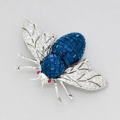 Sapphire, Diamond and 18K White Gold Bee Brooch, with ruby eyes. 18k white gold