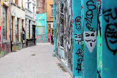 Street Art photos from Kopstraatje in Antwerp, Belgium— small but colorful alleyway filled with graffiti and street art