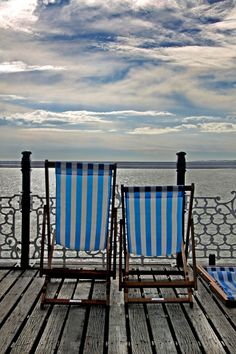 Deck chairs on Brighton Pier, Where I would love to be at any given time.