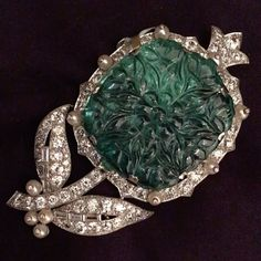 Art Deco emerald and diamond brooch by Cartier featured on the front cover of today's highly successful sale of Magnificent Jewels in New York. A great way to end our 250 year celebrations. @christiesjewels