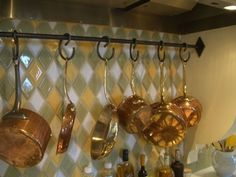 I love this pot rack designed by Brooke Giannetti. Over stove after remove hood.