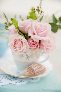 Pink roses in an antique teacup | Photo by Erika Parker