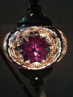 """Half Heart Mosaic Table Lamp with brass base.  All lamps are handmade using recycled colored glass and beads. Glass globe 5 1/2"""" diameter by 17 1/2"""" height. 8 ft cord with switch . 15W candelabra base light bulb included. Suggested light bulb up to 25 W."""