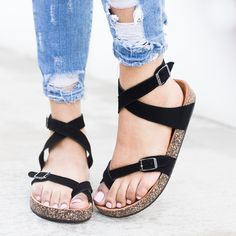 These designer inspired sandals are so cute! They feature a cork style sole and feature a cute ankle strap hold. These have a side adjustable buckle for the straps and go so well with almost any outfit. These are perfect for Spring/Summer! Model Review: Runs 1/2 size small -- we recommend going 1/2 size up Details: Ankle strap hold Toe hold Side adjustable buckle