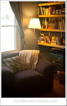 Living Room Reading Nook - The 20 Somethings House Tour - #20somethings #avl #asheville #avlblog #home #house #homedecor #diy #reading #readingnook #nook #books #shelves #chair