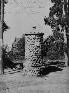 "A drinking fountain for animals located in Burbank, California. The fountain was built in 1890 by the Woman's Christian Temperance Union. Handwritten on the photograph, ""Early day drinking fountain on Olive Street"". Burbank Historical Society. San Fernando Valley History Digital Library."