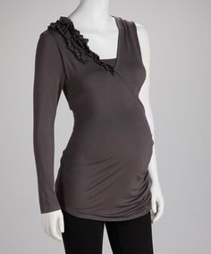 A striking, solid color and flowing silhouette make this maternity and nursing piece fantastically fashionable. Additional folds of fabric make this single-color top even more style-worthy. Simply pull down the neckline for easy feeding!