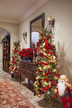 the entry hall showcases two pencil trees the clients twelve days of christmas ornament collections