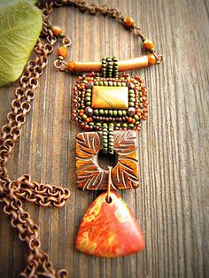 Embroidered pendant with stone components.