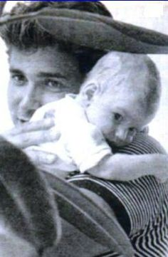 Michael Landon holding his oldest biological son: Michael Landon Jr.