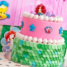 """A cake Ariel & Flounder would ♥! Surprise your mer-girls with yummy fondant """"scales"""" and splashy gumball """"pearls."""" Click for the easy-peasy Little Mermaid cake how-to!"""