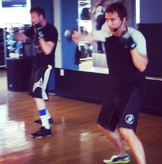 BodyCombat instructors Chuck and Trevor leading a class in Studio 409!