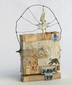 Surprise, by Lisa Kokin. Book fragments, wire, thread, PVA glue, sewing notions, wood, paper, 7.75 x 4.75 x 2.5 inches, 2006