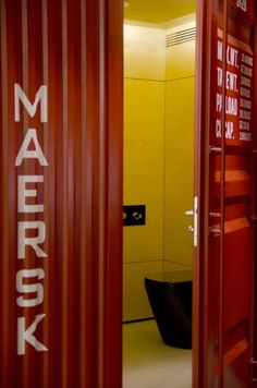 The cargo container in the loft apt houses a bathroom