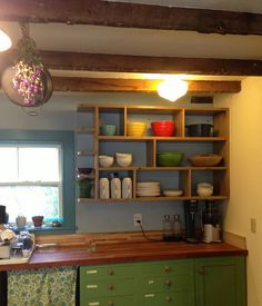 I love this open shelf in place of upper cabinets - on west end of long kitchen wall