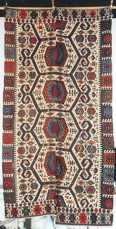 This is a mid 19th century Anatolian kilim. It was woven in Turkey about 1865