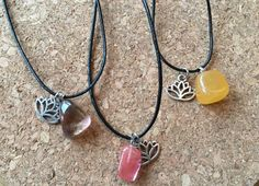 Hand made necklaces with natural stones and a lotus charm on a leather cord. The cord is adjustable with the movable knots. So you can adjust it to the length you want, even turning them into fashionable choker necklaces. The leather cord is around 56 cm when adjusted to its longest. You can choose from different natural stones, see photo 1 from left to right:  1. Ametrine ~ stress reducing. 2. Cherry quartz ~ energizes and symbolises love and romance. 3. Orange calcite ~ cleanses and…