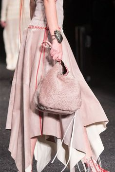 From the return of the clutch, an unexpected triple threat and the embrace of all things fur, follow along as we spotlight the biggest trends in bags on the fall 2017 runways.
