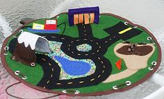 Another circular play mat with a draw string...check out the mountain pass and the rocks on a string to push with a bulldozer