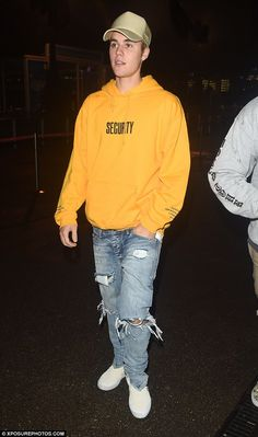 Out and about: Justin Bieber, 22, wore a security sweatshirt made for his dates at London's O2 Arena while going out for dinner after his show Wednesday