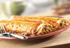 Easy Beef Enchilada Recipe  |  campbellskitchen.com  ~  These flavorful enchiladas make a simple, delicious and filling supper!