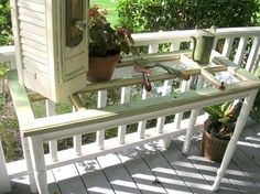 old windows ~ console table (be careful when making a table from an old window. the glass is NOT tempered and can break easily. put a piece of tempered glass or plexiglass over top or change out the glass)